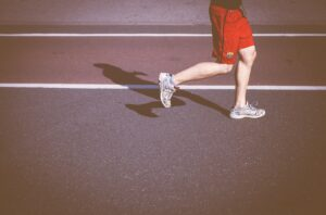 running man in sports shoes